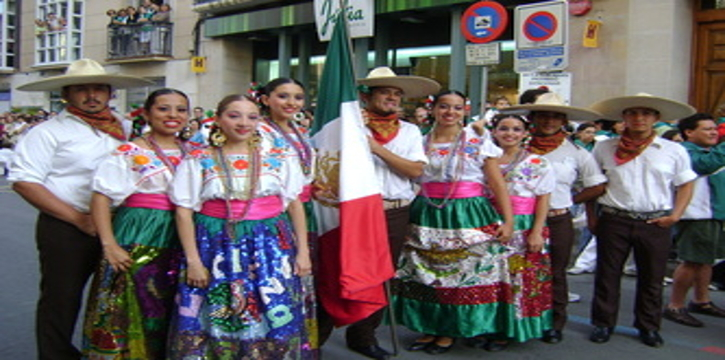 Dancers posing with Mexico flag after parade