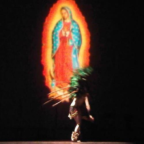 Lone Aztek dancer in from of the Virgin Mary