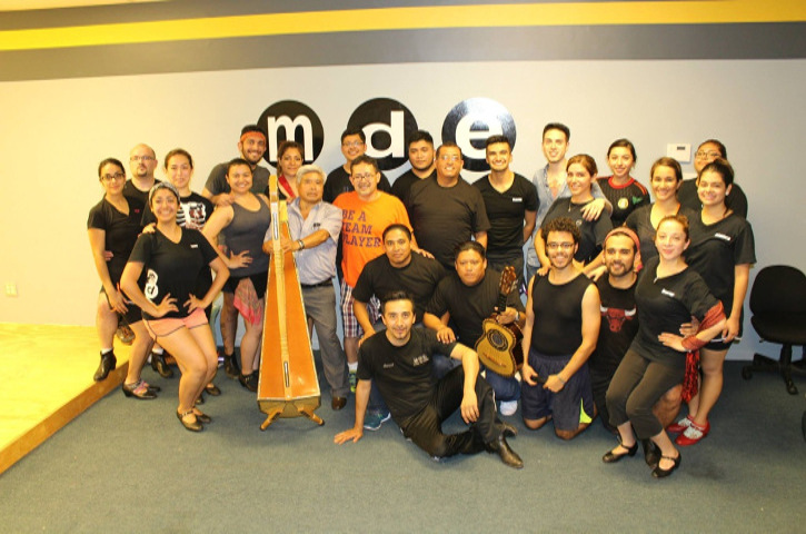 Group of dancers and musicians posing after workshop